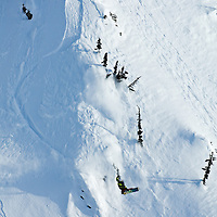 Professional snowboarder Mads Jonsson blasts a big method air off a natural feature in the backcountry near Terrace, British Columbia, Canada.