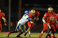 Lafayette High's Devin Thomas (18) is sacked by Memphis University School's Bobby Lewis (56) in Oxford, Miss. on Friday, September 27, 2013. MUS won.