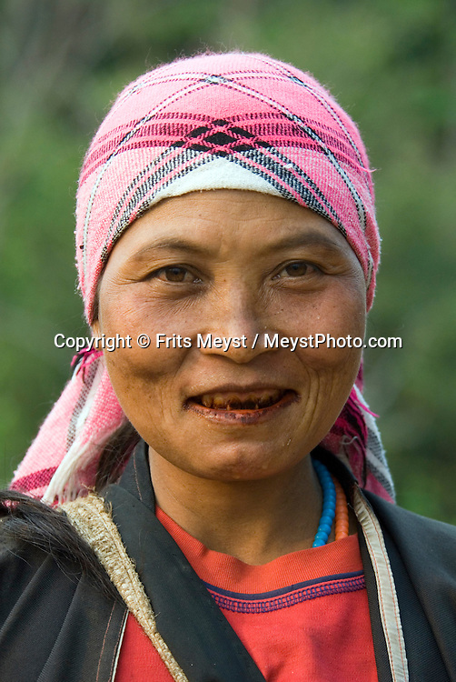 Doi Mae Salong, Chiang Rai, Northern Thailand, March 2007. A Lisu hilltribe woman in her village. The province of Chiang Rai offers a variety of activities, like mountain biking, trekking and elephant and longtail boat riding  in a mountainous landscape carved out by big rivers. Photo by Frits Meyst/Adventure4ever.com