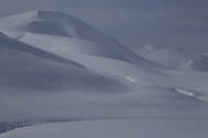 Snowy landscape in April in mountains between Longyearbyen and Barentsburg; Svalbard, Norway.
