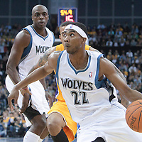 04 October 2010: Minnesota Timberwolves guard Corey Brewer #22 drives past Los Angeles Lakers Matt Barnes during the Minnesota Timberwolves 111-92 victory over the Los Angeles Lakers, during 2010 NBA Europe Live, at the O2 Arena in London, England.