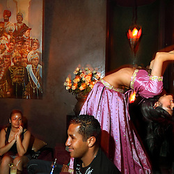Belly dancers perform for patrons inside the bar section of restaurant Comptoir Darna in Marrakech, Morocco on May 9, 2009.