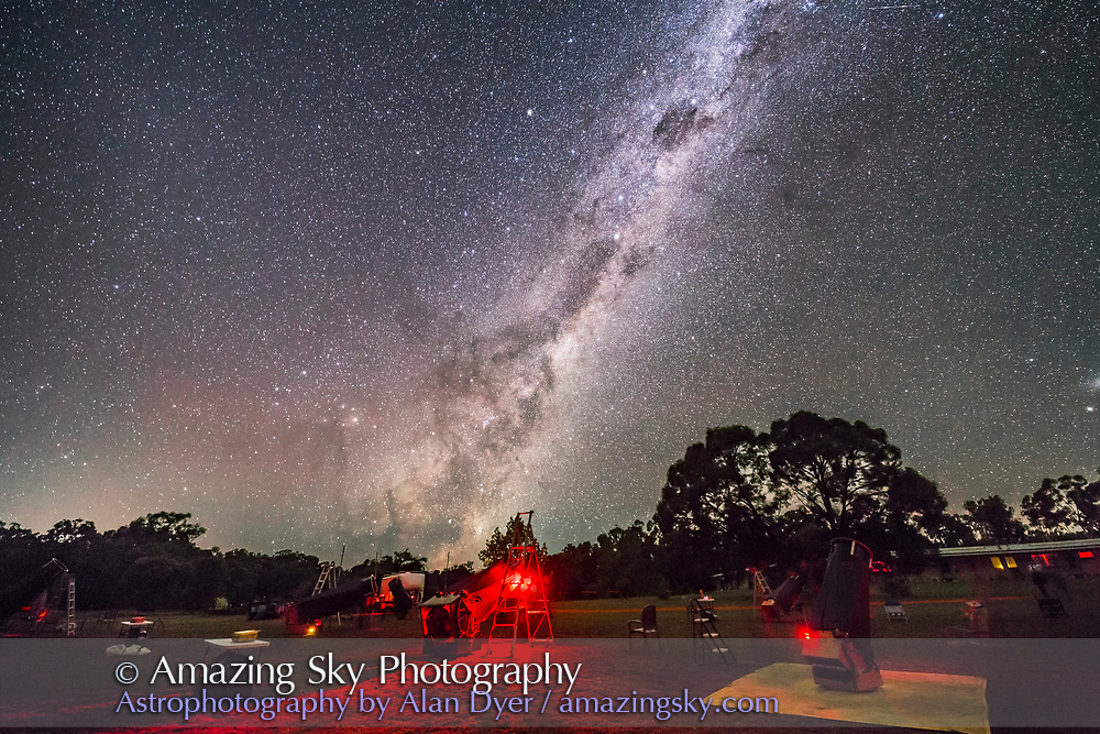 The Dark Emu formation in the southern Milky Way rising at the 2017 OzSky Star Party near Coonabarabran, NSW, Australia, with a foreground of telescopes. <br /> <br /> This is a stack of 4 x 25-second exposures for the ground and one exposure for the sky, with the 14mm Rokinon lens at f/2.5 and Canon 6D at ISO 6400.