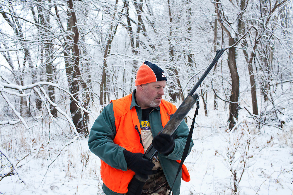 Donovan Nokes after killing and field dressing a young buck on Sunday, December 4, 2011 in Webster City, IA.