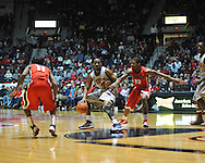 "Ole Miss' LaDarius White (10) vs. Georgia's Kenny Gaines (12) at the C.M. ""Tad"" Smith Coliseum on Saturday, February 16, 2013. (AP Photo/Oxford Eagle, Bruce Newman)"