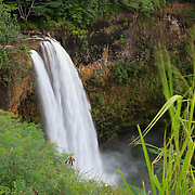 The Wailua River plunges 173 feet into a lush gorge on the Hawaiian island of Kauai. Wailua Falls was featured in the opening credits of the TV show Fantasy Island.