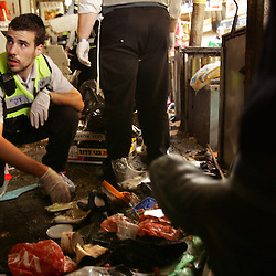 Israeli rescue workers are seen clearing the scene of a suicide bomb attack in Tel Aviv, Israel, Nov. 1, 2004. Three people were killed and dozens were wounded when Palestinian Aamer Alfar, 16, blew himself up in a crowded open-air food market in the heart of Israel's commercial capital. He was from the Askar refugee camp near the northern West Bank city of Nablus.