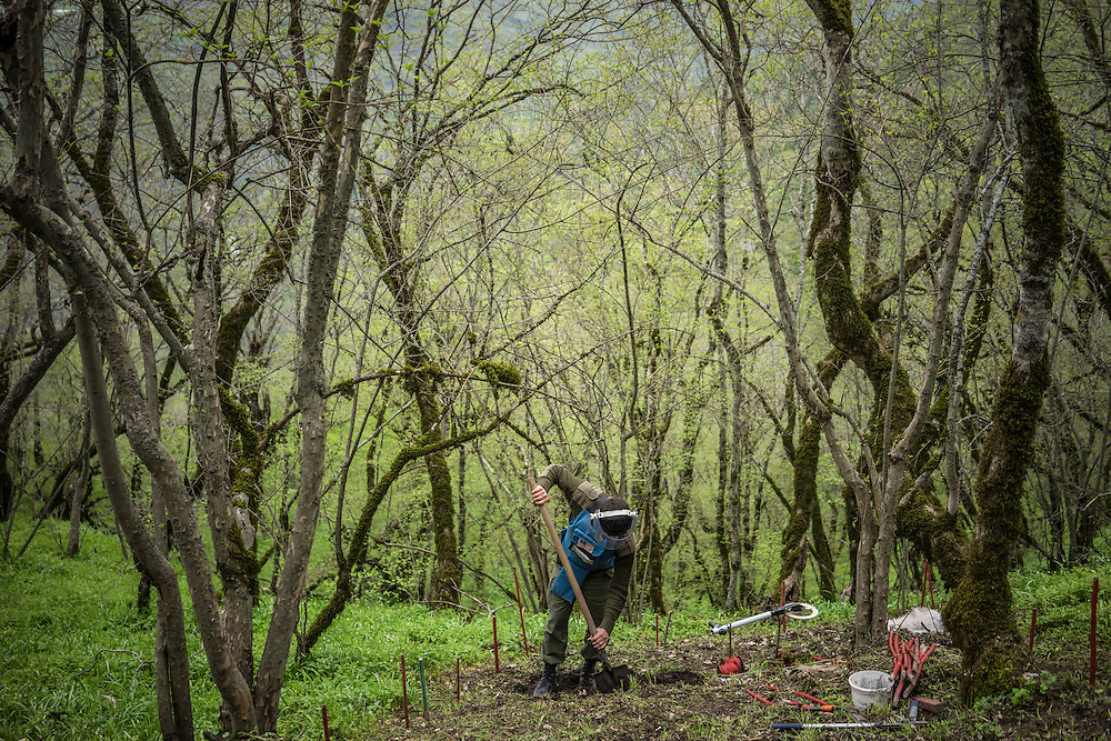 HAGOB KAMARI, NAGORNO-KARABAKH - APRIL 20: Arkadiy Aghajanyan, a sapper with the charity HALO Trust, works to dig a staircase into the side of a steep hill that will soon be cleared of land mines on April 20, 2015 in Hagob Kamari, Nagorno-Karabakh. Since signing a ceasefire in a war with Azerbaijan in 1994, Nagorno-Karabakh, officially part of Azerbaijan, has functioned as a self-declared independent republic and de facto part of Armenia, with hostilities along the line of contact between Nagorno-Karabakh and Azerbaijan occasionally flaring up and causing casualties. (Photo by Brendan Hoffman/Getty Images) *** Local Caption ***