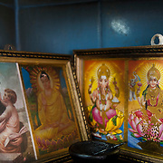 A restaurant in Newham Square has an altar with Catholic, Buddhist and Hindu pictures.