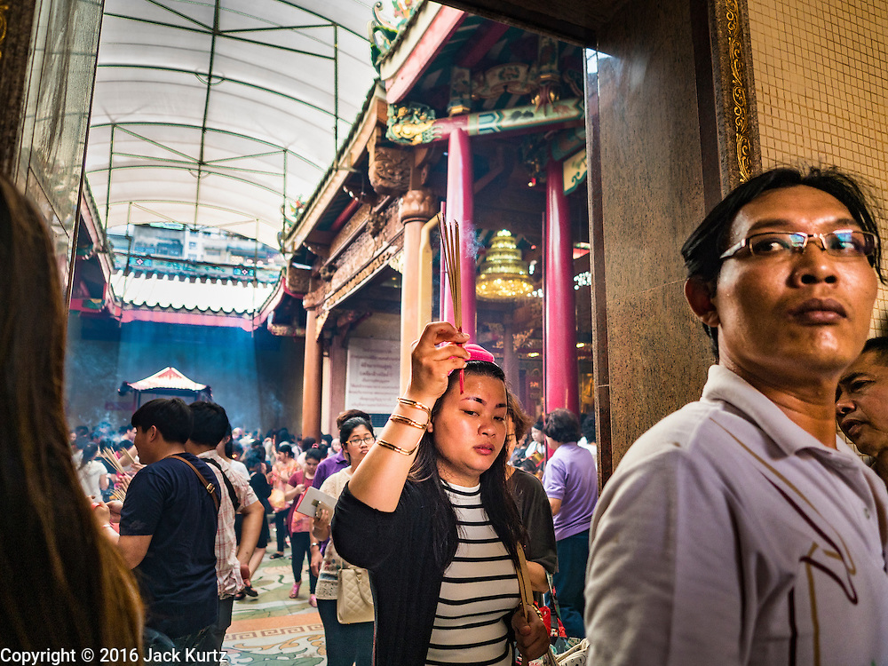 "31 JANUARY 2016 - BANGKOK, THAILAND: People carry incense and make merit at Wat Mangon Kamlawat, the largest Mahayana (Chinese) Buddhist temple in Bangkok, before the celebration of Chinese New Year. Thailand has the largest overseas Chinese population in the world; about 14 percent of Thais are of Chinese ancestry and some Chinese holidays, especially Chinese New Year, are widely celebrated in Thailand. Chinese New Year, also called Lunar New Year or Tet (in Vietnamese communities) starts Monday February 8. The coming year will be the ""Year of the Monkey.""           PHOTO BY JACK KURTZ"