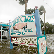 The front entrance to Faraway Inn in Cedar Key, Florida is underwater as the surge in Tropical Storm Alberto comes ashore June13, 2006. REUTERS/Scott Audette