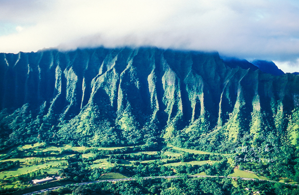 Aerial of H-3 Freeway & Koolau Golf Course under Koolau Mountains, Oahu, Hawaii