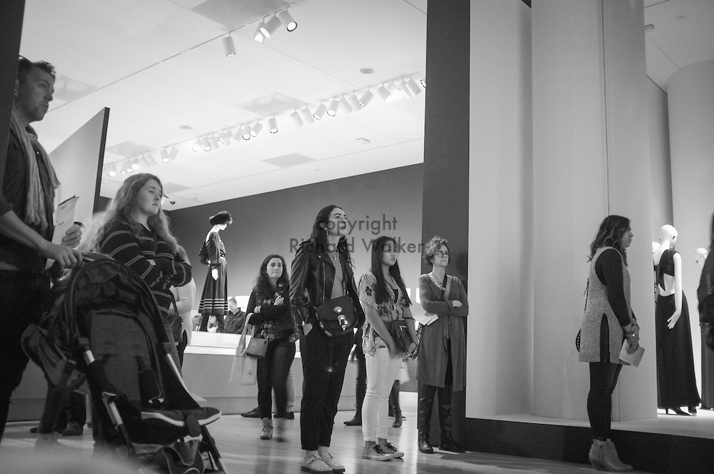 2016 October 22 - People watch a video at Seattle Art Museum as part of Yves St. Laurent exhibition, Seattle, WA, USA. By Richard Walker
