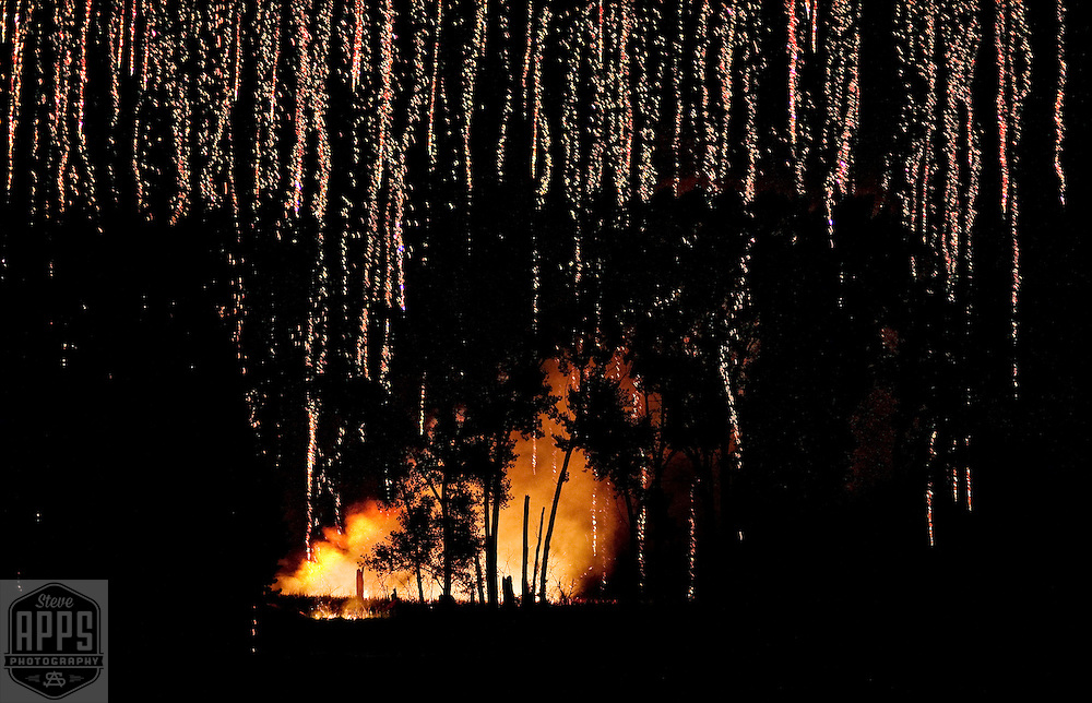..A local fireworks display starts a brush fire during a  celebration of the 4th of July in Madison, Wisconsin