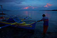 Full moon setting over Wasile Bay, Halmahera with pumpboat we used to travel from Foli to Labilabi along the Halmahera coast.<br /> Alfred Russel Wallace also travel around Halmahera by local boat.