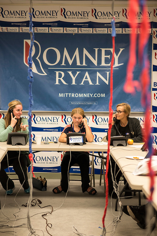 photo by Matt Roth.Wednesday, October 17, 2012.Assignment ID: 30133078A..Volunteers Ashley Pisisnki, 11, is flanked by her mom, Patrice Pisinski, right, and Cathy Tripodi, left, make calls at the Romney's Virginia Headquarters' phone bank in Arlington Wednesday, October 17, 2012.
