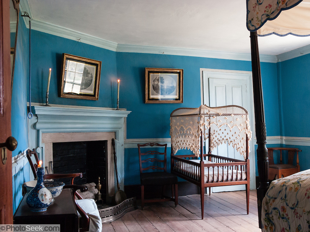 Inside the Mount Vernon house, a bedroom is depicted as in 1799, the last year of Washington's life. Mount Vernon, Virginia, was the plantation home of George Washington, the first President of the United States (1789-1797). The mansion is built of wood in neoclassical Georgian architectural style on the banks of the Potomac River. Mount Vernon estate was designated a National Historic Landmark in 1960 and is owned and maintained in trust by The Mount Vernon Ladies' Association. The estate served as neutral ground for both sides during the American Civil War, although fighting raged across the nearby countryside. George Washington, who lived 1732-1799, was one of the Founding Fathers of the United States of America (USA), serving as the commander-in-chief of the Continental Army during the American Revolutionary War, and presiding over the convention that drafted the Constitution in 1787. Named in his honor are Washington, D.C. (the District of Columbia, capital of the United States) and the State of Washington on the Pacific Coast.