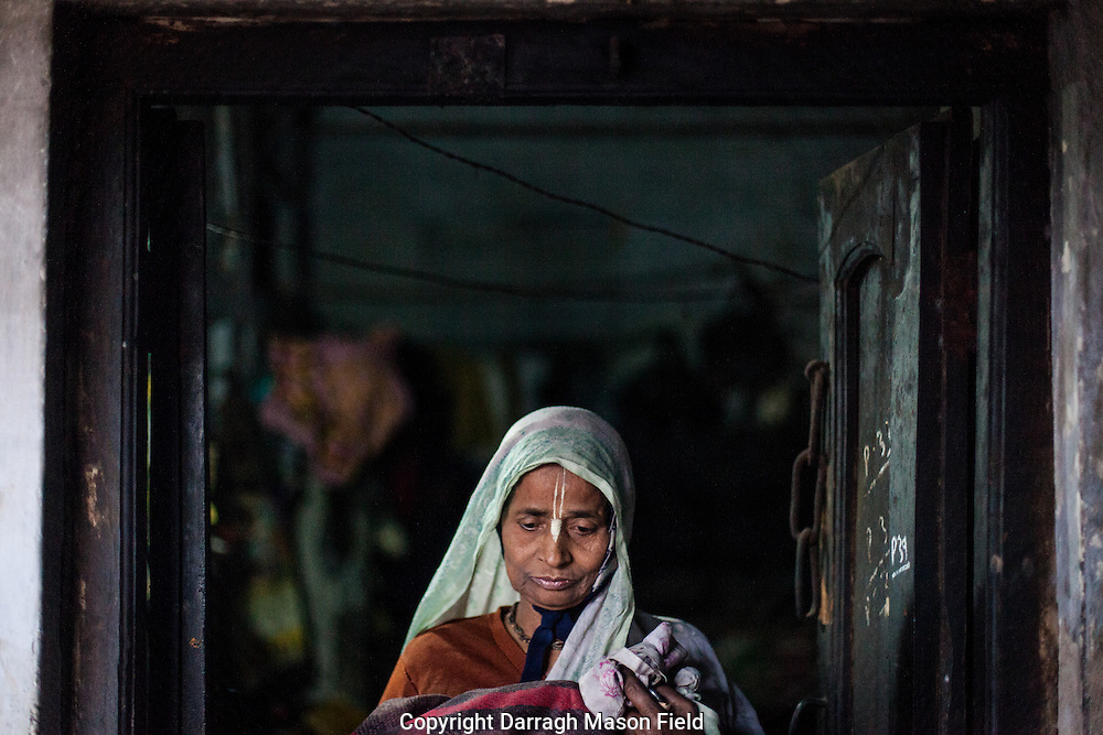 A widow from West Bengal outside the room she shares with four others