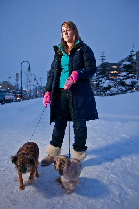 """Jayme Keller with her dogs, Daphne and Sophie, in front of State of Alaska Court House, downtown, Anchorage.  """"Daphne and Sophie refused to go outside because of the deep snow, so I brought them downtown because I knew it would be cleared."""""""