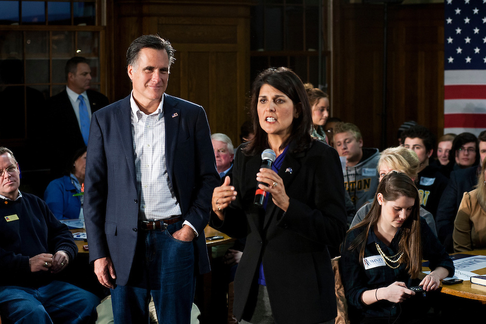 Republican presidential candidate Mitt Romney, left, listens as South Carolina Governor Nikki Haley introduces him at a spaghetti dinner on Friday, January 6, 2012 in Tilton, NH.
