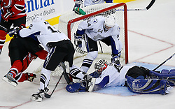 Nov 5, 2008; Newark, NJ, USA; New Jersey Devils left wing Zach Parise (9) gets hit by Tampa Bay Lightning left wing Ryan Malone (12) after a save by Tampa Bay Lightning goalie Mike Smith (41) during the third period at the Prudential Center.