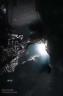 Interior of ice cave formed inside glacier by annual meltwaters outside Longyearbyen on Spitsbergen island, Svalbard, Norway.