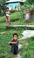 Three young children outside a house, Palawan, Philippines