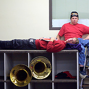 """Senior tuba players  Brandon Punt, left, and Darren Hogland, relax in the band room before leaving for Marshall, Minnesota, for the first field competiton of the year for MOC-Floyd Valley's High School's band.  """"The tuba section is the low stress section of the band,"""" said Punt, who was assigned the instrument in the 5th grade.  The MOC-Floyd Valley High School band has won numerous state and national awards for their excellence and is made up 180 of the school's 360 students.  The band members develop a strong bond during the year."""