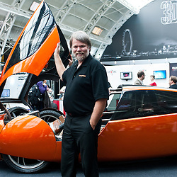London, UK - 7 November 2013: Jim Kor, a mechanical engineer and president of Kor Ecologic, poses next to URBEE, the first car with a 3D printed body on show at the 3D Printshow at the Business Design Centre in London.<br /> The Show brings together the biggest names in 3D printing technology alongside the most creative, exciting and innovative individuals using additive processes today.