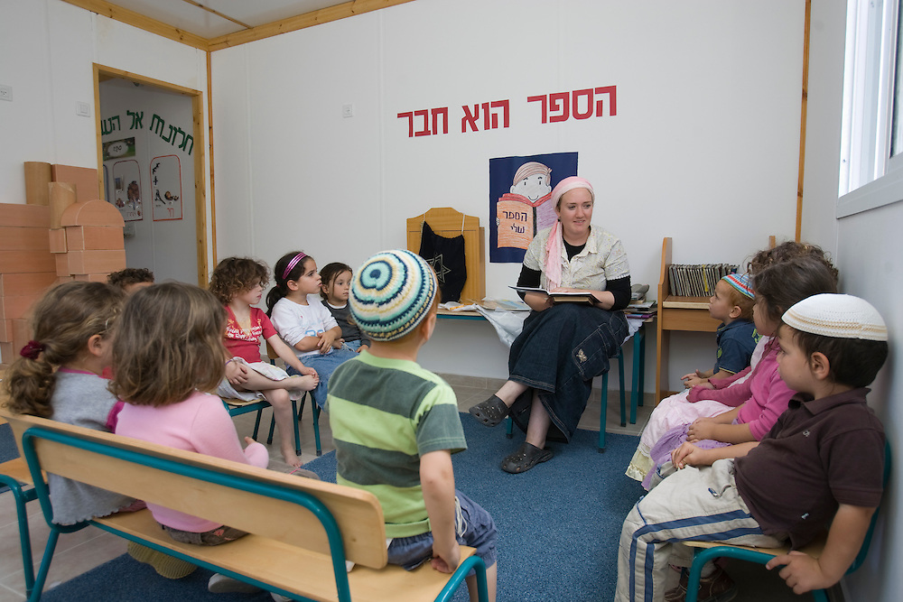 Settler children seats during a lecture in the kindergarten of Havat Gilad.