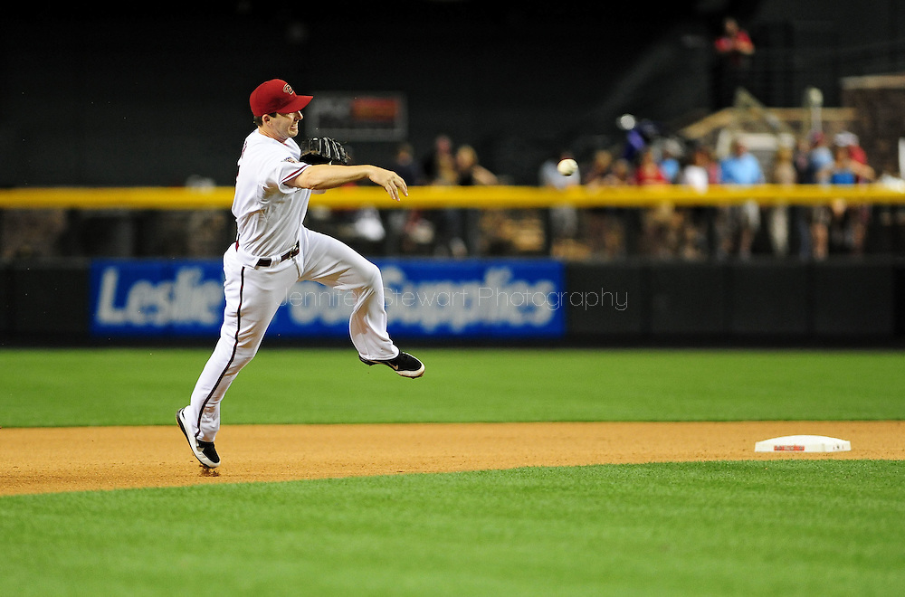 Apr. 29 2011; Phoenix, AZ, USA; Arizona Diamondbacks short stop Stephen Drew (6) makes the force play out at first against the Chicago Cubs at Chase Field. The Cubs defeated the Diamondbacks 4-2.  Mandatory Credit: Jennifer Stewart-US PRESSWIRE