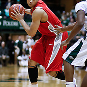 SHOT 2/23/10 10:09:35 PM - New Mexico's Darington Hobson looks to pass or drive against Colorado State during the second half of their regular season Mountain West Conference game at Moby Arena in Fort Collins, Co. New Mexico survived a tight game winning 72-66. (Photo by Marc Piscotty / © 2010)