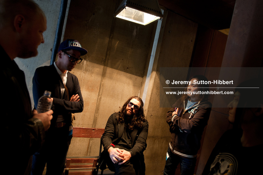 Ian Astbury, lead singer with The Cult, chats with fans after singing on stage as part of 'BXI'- a musical collaboration with Japanese band 'Boris', in the 'WWW' club in Shibuya district of Tokyo, Japan, Sunday 28th November 2010.