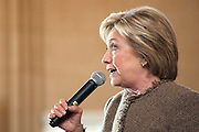 February 26, 2016 - Atlanta, Georgia: Hillary Clinton rerouted her Atlanta campaign stop at the last minute to City Hall after orginally planning a rally at nearby Georgia State.  In the old council chambers she rallied her supporters with Mayor Kasim Reed, who's endorsed the former secretary of state, before South Carolina's primary and a crucial Super Tuesday in which Georgians will cast their primary votes. <br /> <br /> After a brief speech to an overflow crowd in City Hall's atrium, Clinton gave an approximately 40-minute stump speech in the Old Atlanta City Council Chambers on the third floor of City Hall Tower. <br /> <br /> With Reed by her side &mdash; he's one of Clinton's most vocal supporters in Georgia &mdash; and an estimated 400 supporters in the crowd, Clinton promised to &quot;break down economic barriers&quot; to help the middle class, push for clean energy, and fight for equal pay for equal work, an issue that generated loud cheers. Clinton, who's leading U.S. Sen. Bernie Sanders in Georgia polls but watching his support rise nationally, called for background checks on gun purchases and pledged to try to make higher education more affordable.