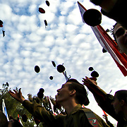 Israeli soldiers toss their red paratroopers berets awarded to them after completing an overnight march, during a ceremony at Ammunition Hill in Jerusalem February 20, 2012. Photo by Oren Nahshon.
