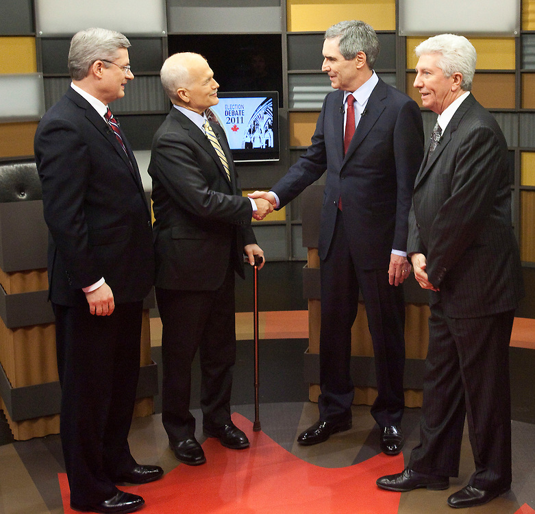 NDP leader Jack Layton, 2nd left and Liberal leader Michael Ignatieff  shake hands as they and Conservative leader Stephen Harper and Bloc Quebecois leader Gilles Duceppe gather for a group photo before the english language debate in Ottawa, April 12, 2011.<br /> AFP/GEOFF ROBINS/STR
