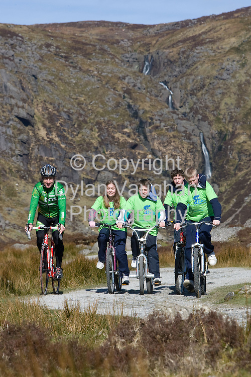 19/3/2008.free picture no charge for use.World-renowned cyclist, Sean Kelly, is inviting fellow enthusiasts to test their pedal power and join in a scenic cycle tour through county Waterford . The Sean Kelly Cycling Tour of Waterford was officially launched by the cyclist himself at the Mahon Falls yesterday(Wednesday 19th March). The tour will be held on Sunday, August 24th, in the beautiful and cycle-friendly County Waterford and consists of three different routes to test the mettle of cyclists of various abilities and endurance levels..Pictured with sean is from left Siobhan Bray aged 13, Eoin Bray aged 10, James Green aged 14 and Brian Green aged 16..Picture Dylan Vaughan
