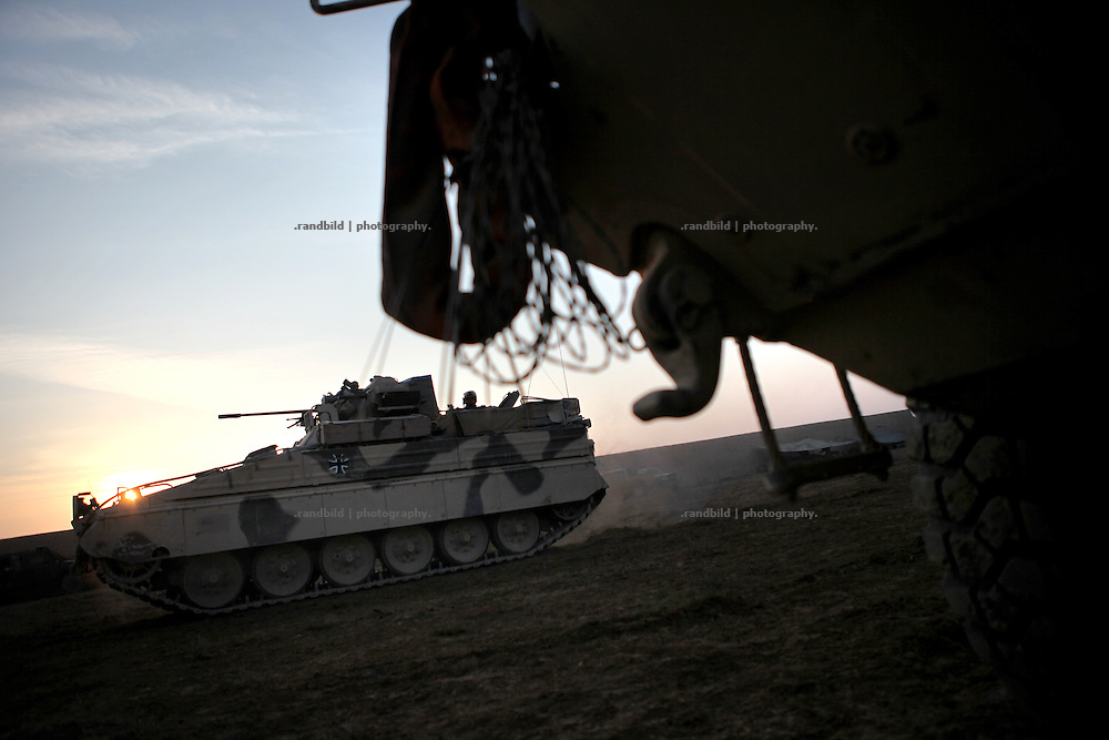A german Marder (Marten) battle tank leaves the Safe House at dawn. In late October 2011 Kunduz based 3.Task Force started a several days operation in and around Nawabad (District Chahar Darah), west of Kunduz, northern Afghanistan. During the Operation Orpheus about 100 german infantery soldiers rolled out for patrols through the town and surrounding areas, which were expected as a retreat zone of insurgents.