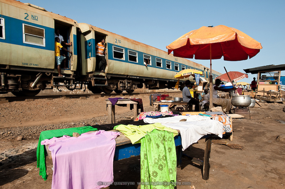 A train line running along one boder of Agbogbloshie, a slum in Ghana's capital Accra, serves as a thoroughfare and de facto commerce district.