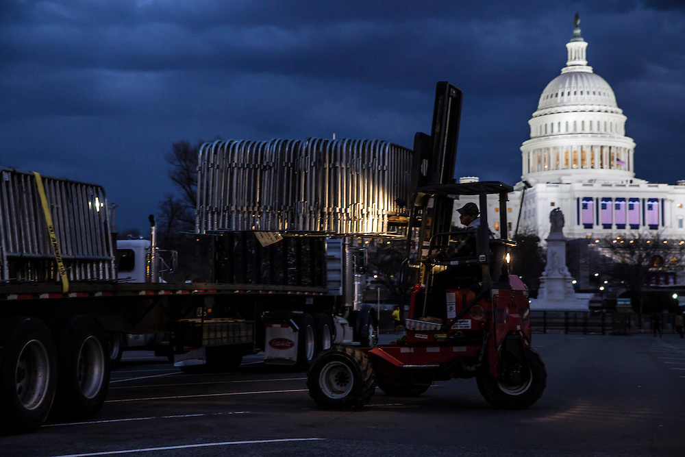 Bicycle racks are loaded back onto a truck as crews clean up near the U.S. Capitol following the Inauguration of President Barack Obama on Monday, January 21, 2013 in Washington, DC.