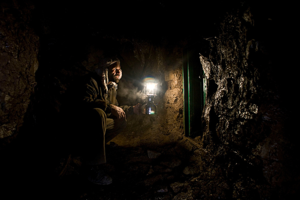 The men who mine for emeralds in the Panshir mountains work at altitudes nearing 3000 meters above sea level. The crawl though tunnels of up to 100 meters into the mountain side without any safety equipment. The mountains are covered in snow for much of the year and temperatures plummet far below zero Celsius. The miners drill holes in the rock face and use home-made explosives to blow the rock apart. Rock-fall and poisonous gases claim lives and some miners go many years without finding any emeralds of significant value. Khenj, Panshir Mountains, Afghanistan on the 19th of April 2009..