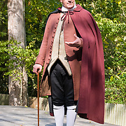 """A professional actor portrays Patrick Henry with gusto in Colonial Williamsburg. In 1776, Patrick Henry became the first governor of the Commonwealth of Virginia, newly formed with the world's first written constitution adopted by the people's representatives. He lived May 29, 1736 - June 6, 1799, and was most remembered for his """"Give me Liberty, or give me Death!"""" speech. Patrick henry was one of the most influential and radical advocates of the American Revolution and republicanism, especially in his denunciations of corruption in government officials and his defense of historic rights. Colonial Williamsburg is the historic district of the independent city of Williamsburg, Virginia, which was colonial Virginia's capital from 1699 to 1780, and a center of education and culture. Here, Thomas Jefferson, Patrick Henry, James Monroe, James Madison, George Wythe, Peyton Randolph, and dozens more helped mold democracy in the Commonwealth of Virginia and the United States. For licensing options, please inquire."""