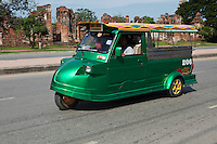 "Ayutthaya Style Tuk-Tuk - The vehicles known as Tuk-Tuks originated in Japan by Daihatsu.  They were then subsequently produced in Thailand many years later evolving as a motorized relative of the rickshaw. The Tuk-Tuk was given its name from the rather rough sound of the early models. The single stroke motor powering the first three-wheelers had a distinctive hum when operating, and the ""tuk-tuk-tuk-tuk-tuk"" sound became a familiar sound to many in need of quick and convenient transportation in Bangkok. The technology and quality have improved over the years, while emerging as one of Thailand's most recognizable and identifiable symbols. Ayuthaya style Tuk-Tuks are built by hand, all the buyer has to do is turn up with the part of the old frame with the chasis number stamped on it and a new Tuk-Tuk is built around it."