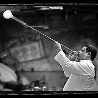 Cairo, Egypt  June 2008<br /> For 4 centuries, Hassan's family has been blowing glass to make lamps, pots, vases and handicrafts.  <br /> Photo: Ezequiel Scagnetti