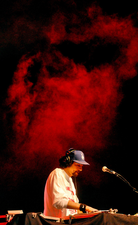 (Staff Photo by Matt Roth)..A tuft of stage fog looms over Cypress Hill's DJ Muggs during their main stage performance Saturday May 27, 2006 at the HFStival....More than 40,000 attendees, 13,000 less than the previous year's one day affair, flocked to the 17th annual HFSival, which was held, for the first time, at the Merriweather Post Pavillion Saturday May 27 and 28, 2006. Ticket prices were reportedly the highest yet, with pit seats going for $100..