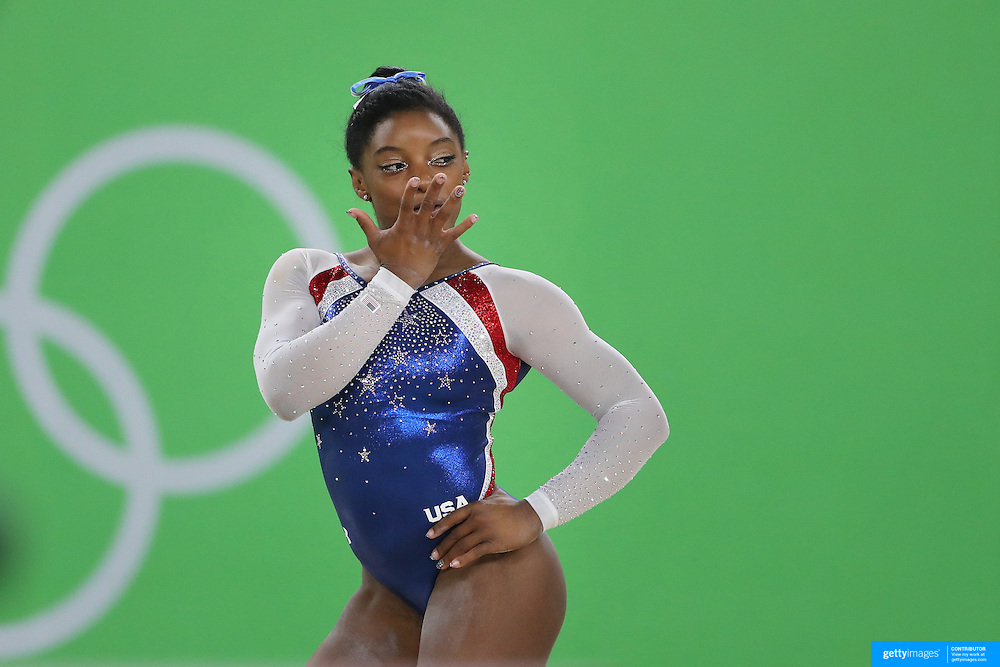 Gymnastics - Olympics: Day 6  Simone Biles of the United States performs her routine on the floor during the Artistic Gymnastics Women's Individual All-Around Final at the Rio Olympic Arena on August 11, 2016 in Rio de Janeiro, Brazil. (Photo by Tim Clayton/Corbis via Getty Images)
