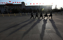 A Peoples Liberation Army soldier stands guard in front the Great Hall of People before the 11th National People's Congress (NPC) held at the Great Hall of the People in Beijing, China 05 March 2010. The NPC, China's leading legislative body and all the motions proposed were passed with overwhelming support though no votes were higher than in recent years with some motions having more than 500 opposing versus more than 2,000 in favour.