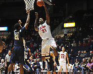"Ole Miss' Murphy Holloway (31) shoots by East Tennessee State's John Walton (21) at the C.M. ""Tad"" Smith Coliseum in Oxford, Miss. on Saturday, December 14, 2012. Mississippi won 77-55 to improve to 7-1. (AP Photo/Oxford Eagle, Bruce Newman).."