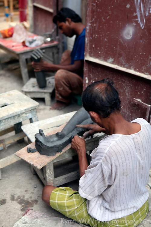 Asia, India, Calcutta. A clay sculptor from the potter's village of Kumartuli in Calcutta.