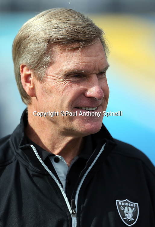Oakland Raiders senior offensive assistant Al Saunders smiles while having a conversation on the field before the NFL week 17 football game against the San Diego Chargers on Sunday, Dec. 30, 2012 in San Diego. The Chargers won the game 24-21. ©Paul Anthony Spinelli